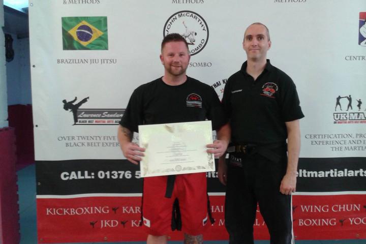 jun-fan-and-muay-thai-black-belts