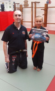 Isobel Moore gaining her orange belt in Matt Fiddes Junior Champs