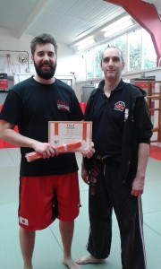Craig Bendon gaining his orange belt in Jun Fan