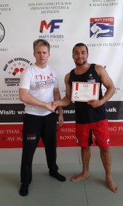 Ben Wallace gaining his red belt in Muay Thai
