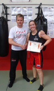 Marina Martin Arias gaining her orange belt in Jun Fan